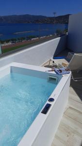 The swimming pool at or near Naiades Marina Hotel