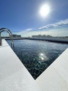 The swimming pool at or near Oporto Airport & Business Hotel