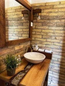 A bathroom at Carpital Residence   CLASSAPART HOTELS
