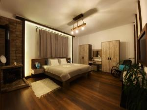 A bed or beds in a room at Carpital Residence   CLASSAPART HOTELS
