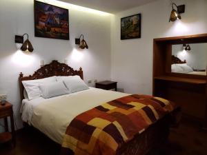 Cama o camas de una habitación en Amaru Inca