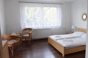 Posteľ alebo postele v izbe v ubytovaní Penzión High Tatras