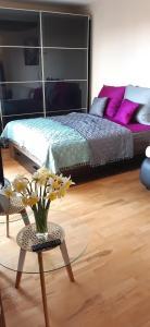 Łóżko lub łóżka w pokoju w obiekcie Apartament 40 Sun & Rain Villa Nord