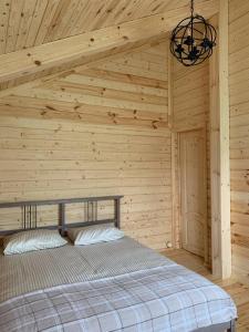 Кровать или кровати в номере Телец