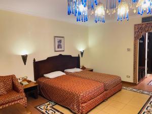 Ліжко або ліжка в номері Sharm Domina Royal Suit