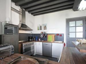 A kitchen or kitchenette at Gîte Laleu, 6 pièces, 10 personnes - FR-1-497-46