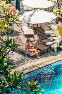 The swimming pool at or near Hotel Tugu Bali
