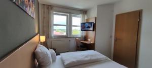 Ein Bett oder Betten in einem Zimmer der Unterkunft Brigel-Hof