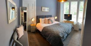 A bed or beds in a room at Haylie Hotel