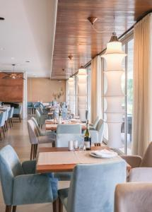 A restaurant or other place to eat at Hotel Vouga
