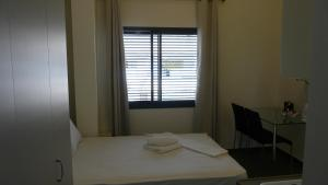 A bed or beds in a room at City Center Apartments