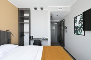 Säng eller sängar i ett rum på Hotel Fridhem