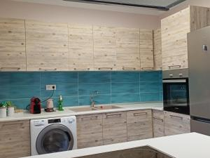 A kitchen or kitchenette at Stay Sunny