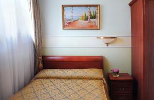 Кровать или кровати в номере Бизнес Отель Спорт