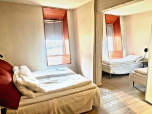 A bed or beds in a room at Preikestolen BaseCamp