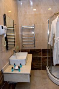 Um banheiro em Ruma Qala Hotel