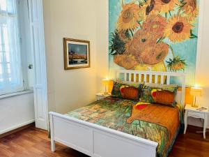 A bed or beds in a room at RarityArt minihotel