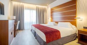 Cama o camas de una habitación en Ilunion Alcora Sevilla