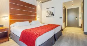 Postelja oz. postelje v sobi nastanitve Ilunion Alcora Sevilla