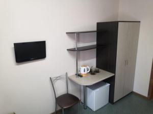 Телевизор и/или развлекательный центр в Mini Hotel Berezka