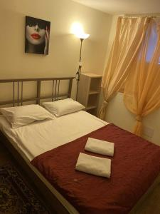 Мини-Отель Линияにあるベッド