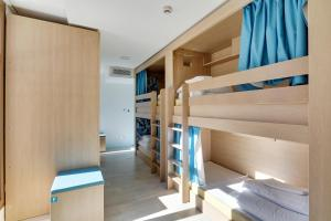 A bunk bed or bunk beds in a room at The People Hostel - Marseille