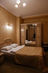 Кровать или кровати в номере Отель Астория