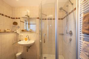 Ein Badezimmer in der Unterkunft Boutique Hotel Angerer