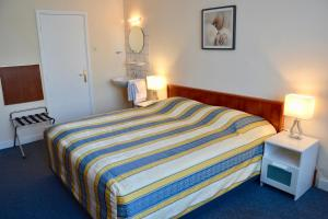 Un ou plusieurs lits dans un hébergement de l'établissement Hotel De Stern