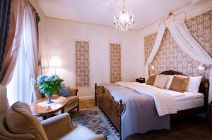 Säng eller sängar i ett rum på Hotel Amalias Hus