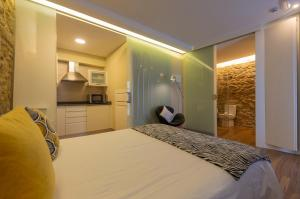 A bed or beds in a room at Apartamentos Praia do Capitàn