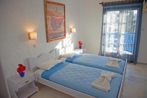 A bed or beds in a room at St.George Valsamitis