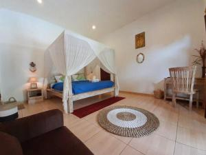 A bed or beds in a room at The Secret Jungle Villas Seminyak