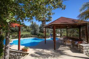 The swimming pool at or near Popi's Residence- The villa