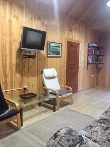 Телевизор и/или развлекательный центр в Гостевой дом в Нурмойле