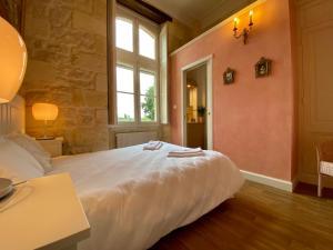 Un ou plusieurs lits dans un hébergement de l'établissement Château Borgeat de Lagrange - chambres d'hôtes