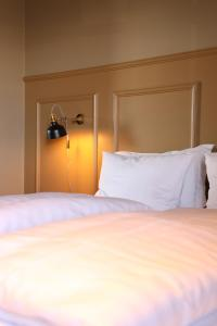 A bed or beds in a room at Hotel Akureyri