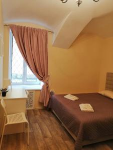 Кровать или кровати в номере Mini-otel Adele