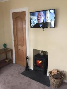 A television and/or entertainment centre at Erradill Cottage