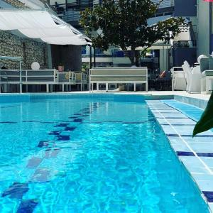 The swimming pool at or close to Olympia Hotel