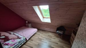 A bed or beds in a room at Sasinko