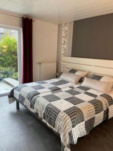 Ein Bett oder Betten in einem Zimmer der Unterkunft Appartements Pension Eckerskorn
