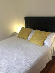 A bed or beds in a room at Angelas - Casa da Galega