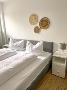 Ein Bett oder Betten in einem Zimmer der Unterkunft Zur Alten Schmiede