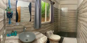 A bathroom at Primaluna Beach Hostel