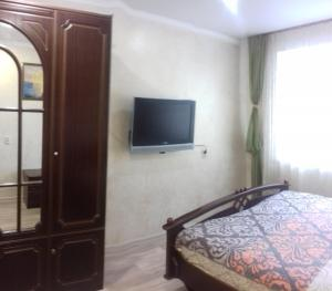 A television and/or entertainment center at Apartment on Lenina 128