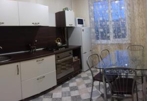 A kitchen or kitchenette at Apartment on Lenina 128