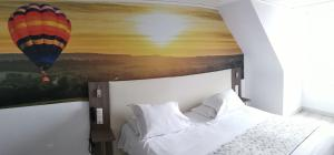 A bed or beds in a room at Best Western Hotel Ile de France