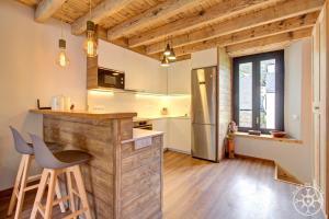 A kitchen or kitchenette at CASA ERA CUMA de Alma de Nieve