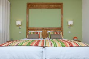 Uma cama ou camas num quarto em Agro-Turismo do Roxo